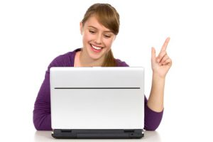 Girl with laptop pointing up